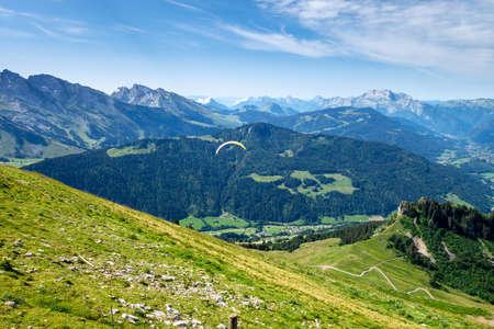 paragliding flight in the mountains. Le Grand-Bornand, Haute-Savoie, France