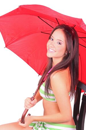 A beautiful woman holding a red umbrella against a white background  photo