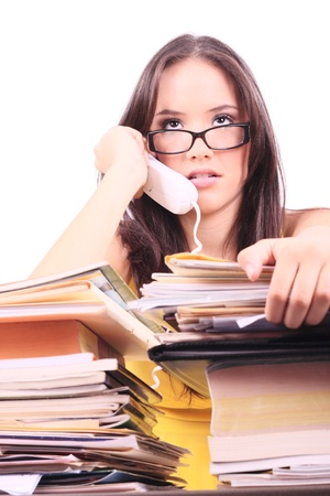 despairing lady office executive with stack of paperwork photo