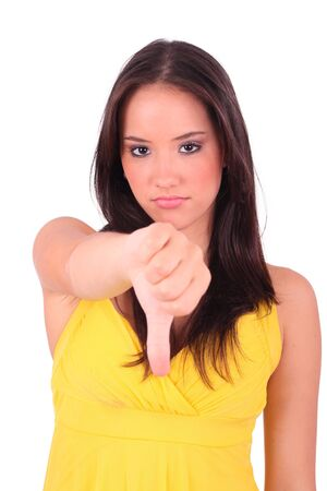 Young woman showing thumbs down  photo