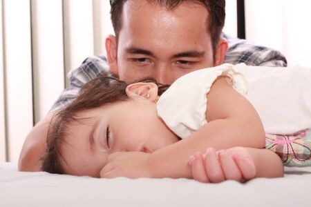 Father watch his beautiful baby while she sleeps