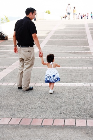 Baby walking like a model with her father Stock Photo - 9662528