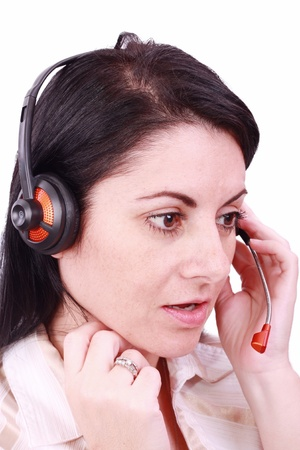 telephonist: A beautiful young telephonist speaking on a headset