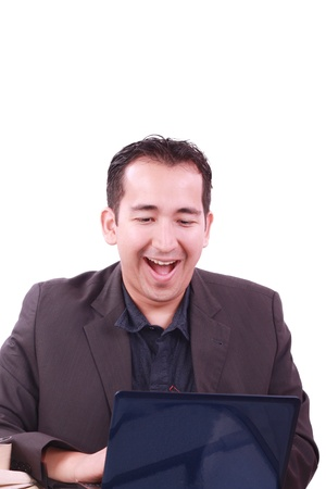 Happy young man working on laptop computer, having fun Stock Photo - 9959947