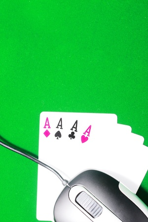 An online gaming concept with computer mouse, four aces and green felt Stock Photo - 9959954