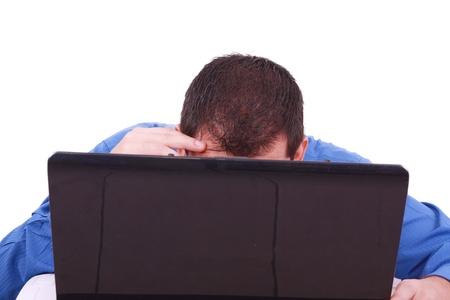 A bald man hiding behind his laptop computer screen.  Stock Photo - 9995485
