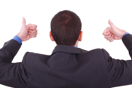 untrustworthy: A businessman gives a thumbs up (back) Stock Photo