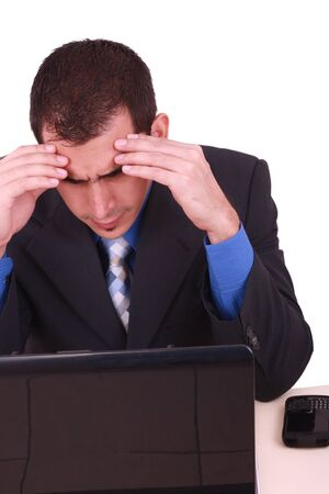 Image of businessman touching his head while looking at monitor with tired expression  photo