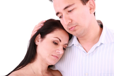 Man comforts woman. Isolated on a white background  photo