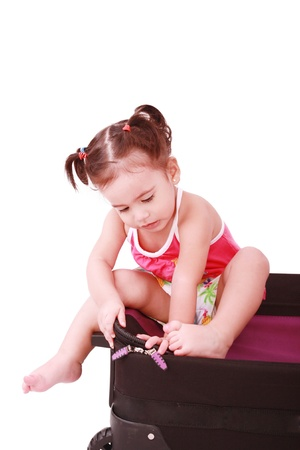 Little girl in a suitcase. Isolated on a white background  photo