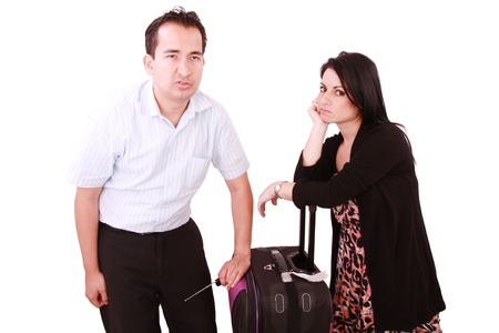 caucasian businesswoman and businessman stand impatiently as they wait for a flight photo