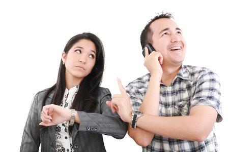 chinesse: give me one minute, caucasian mid adult person talking on cellphone telling to wait one minute to his couple Stock Photo