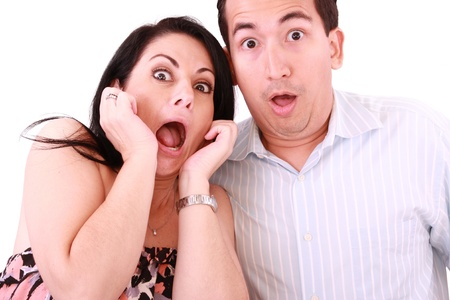 young adult couple in cinema movie theater scared while watching horror film.  photo