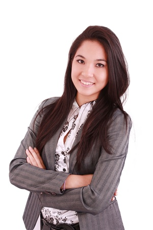 chinesse: portrait of a happy young business woman standing with folded hand against white background
