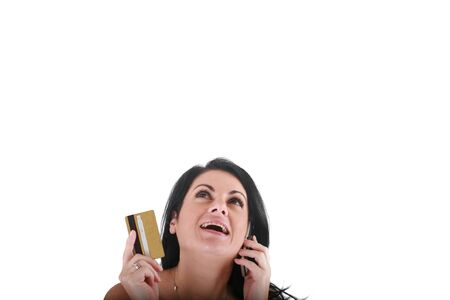 Portrait of smiling young woman using cell phone on white background  photo
