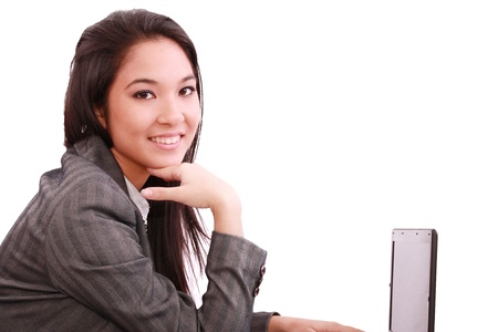 chinesse: beautiful smiling business woman working on laptop