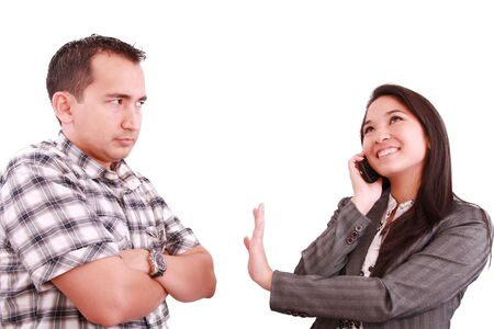 bother: smiling businesswoman on the phone signaling his couple to hold on Stock Photo