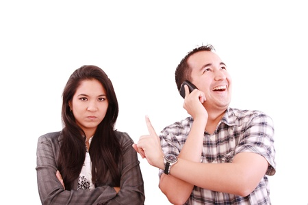 lovers quarrel: happy man talking on the phone, forgetting about his wife