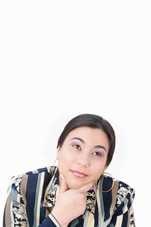 thoughtful woman looking up isolated over white background photo
