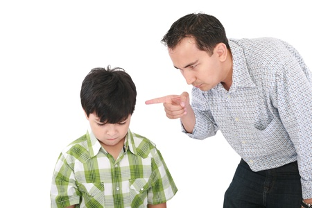 punish: A father is threatening his little boy with a finger