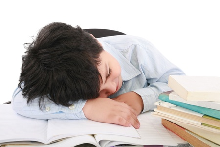 adorable boy tired to study a over white background  photo