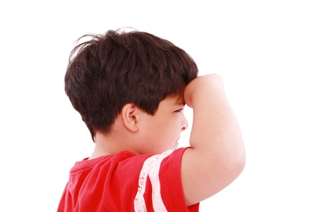 crewcut: boy intently looking far away, isolated on white background  Stock Photo