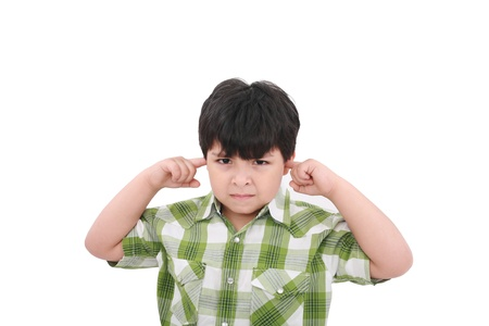 brat: Photo of a boy with his fingers in his ears.  Stock Photo