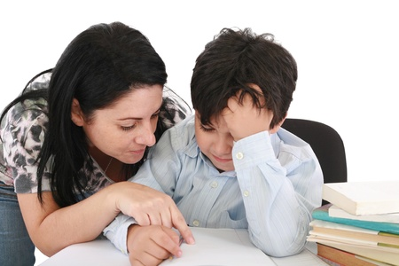 teaching adult: mother helping with homework to her son indoor  Stock Photo