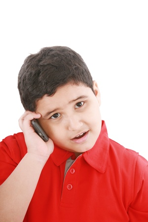 Young boy talking to cell phone, isolated on white background. Stock Photo - 10989610