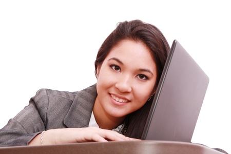 Young business woman on a laptop - isolated on white  photo