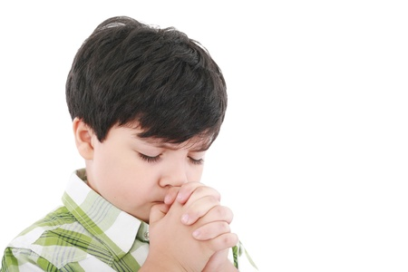 earnestly: A boys prays earnestly to his creator in heaven    Stock Photo