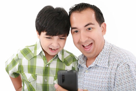 Young father and son was surprised, having read on mobile phone sms. photo