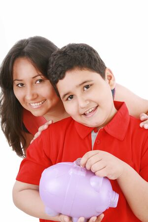Portrait of a caring mother teaching her son to save money in piggybank over white background   photo