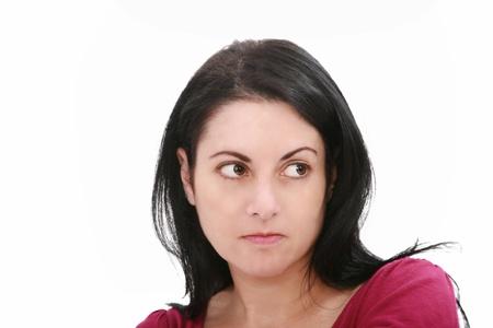 conceiving: Closeup portrait of a serious beautiful woman