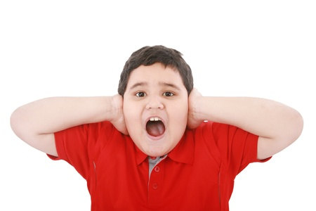crewcut: Horizontal portrait of a young boy yelling  Stock Photo