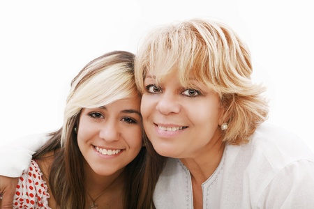 mother and attractive young daughter smiling happily, looking at camera photo