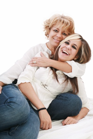 Mother and daughter sitting and laughing on the floor Stock Photo - 11144724