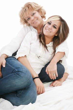 image of a mother and daughter happily together sitting on the floor  photo