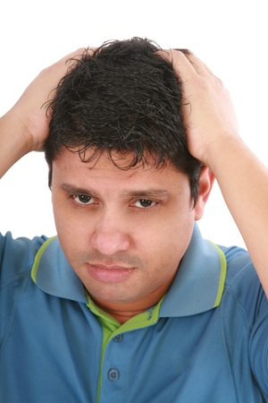 Portrait of young sad man worrying or having pain photo