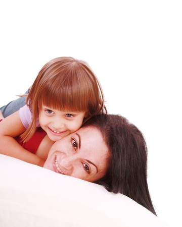 Young Mother and daugther embracing on bed  photo