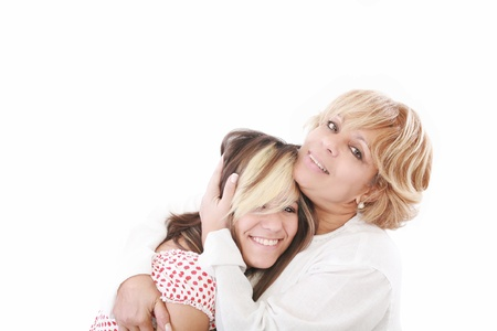 teenage love: beautiful real couple mother in her 50s and teenage daughter Stock Photo