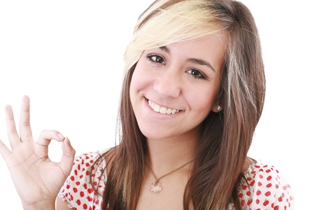 bright picture of lovely teenage girl showing ok sign Stock Photo - 11429681