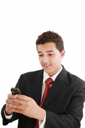 A handsome young business man texting on his phone Stock Photo - 11429821