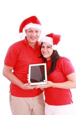 Couple enjoying their new touchpad on christmas  photo