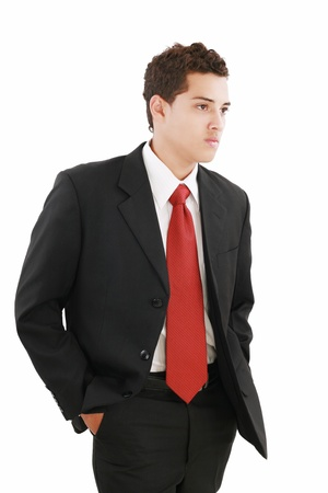 Young businessman over white background. Isolated fresh teenager in suit. photo