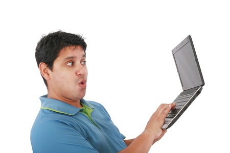 Young man standing, holding a laptop computer, working, looking down, isolated on white.  Stock Photo - 11429817