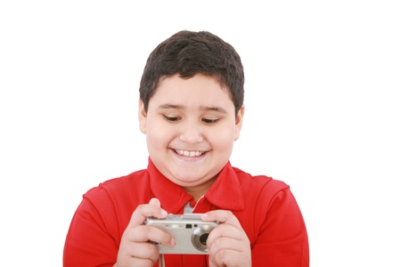 small boy with digital camera on white background  photo
