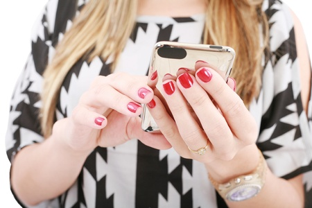 Close shot of woman hand holding a mobile phone typing a sms 