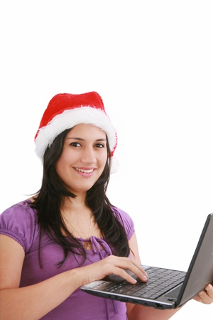 Beautiful business woman is working in office in santa claus hat   photo