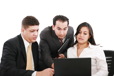 business team looking shocked and worried when looking at the laptop computer on the table    photo
